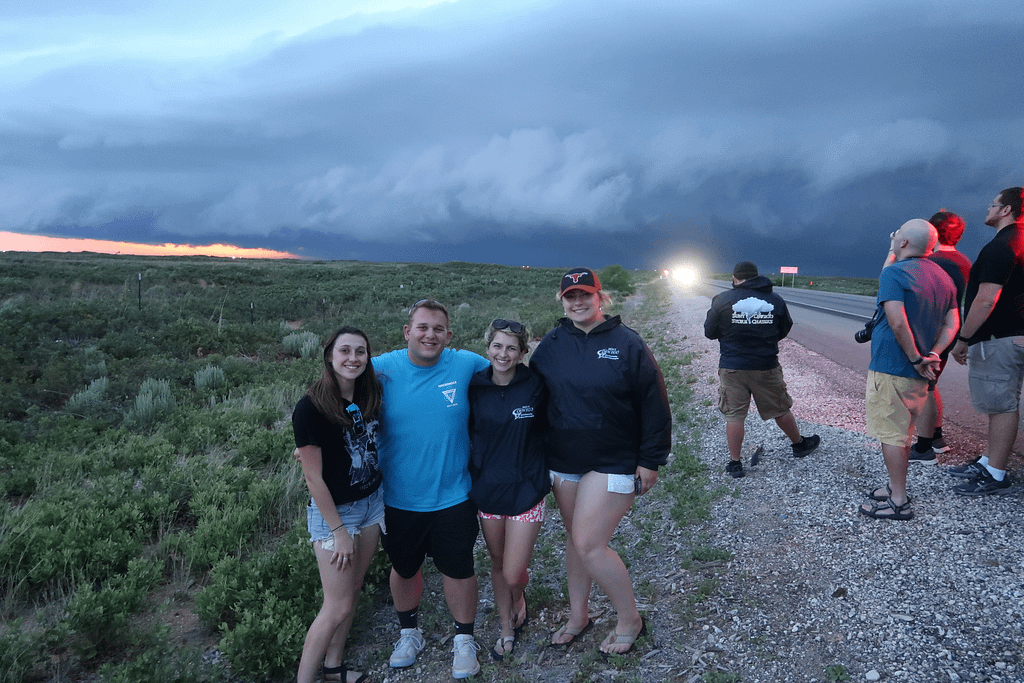 NVU-Lyndon students in front of a shelf cloud in New Mexico. Pictured from left to right: Catie McNeil, Bobby Saba, Camryn Kruger, and Maddie Degroot